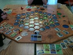 DIY Settlers of Catan Board | BoardGameGeek; Would be impossible to expand on, cumbersome to make, and AWESOME. (could use two pieces of thin board, cut the top one like a stencil and overlay onto bottom one? Also, room for fingers to get at card slots.)