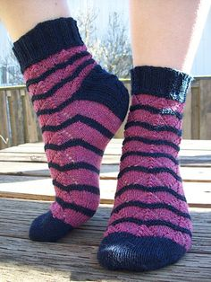 Start date: Jan 23, 2015   Completion date: Feb 27, 2015   Pattern: HiyaHiya Sail Lace Socks Toe Up   Yarn: Reynolds Whiskey in navy and dark pink   Needles: HiyaHiya 2.5mm and 2.75mm   Notes: I added one plain knit round of the new color between color changes just to make it clean and neat. Doesn't affect the looks of the pattern at all   --- hollyisaac (Ravelry Name) said.