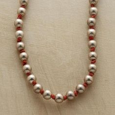 "A classic revisited, with matte sterling silver spheres replacing pearls and burnt orange, waxed linen knotting. Button and loop closure. Handmade in USA. Approx. 20"" to 21""L. $248.00"