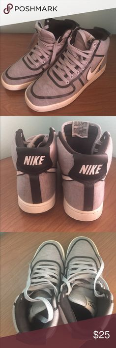 Nike Kicks! Gray and black Nike high top kicks! Soft cotton/canvas. In good condition, evidence of minor wear. There's a small spot on the left shoe (see pics 6, 7 & 8). Nike Shoes Sneakers