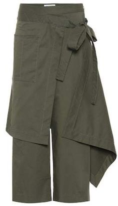 Add an artistic touch to your everyday edit by opting for these draped, folded and knotted pants from Monse. Arriving in olive green, this cotton-blend design features asymmetrical draping that ties at the high waist. Wool Pants, Linen Pants, Fashion Pants, Fashion Dresses, Mode Hijab, Clothing Hacks, Cute Skirts, Skirt Pants, Mode Inspiration
