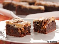 Fudge Cheesecake Bars - Does it get any better than fudgy cheesecake? Bring it to a potluck to share with friends or better yet, keep it all for yourself!