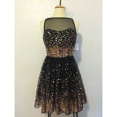 NWT ⚜ Black Prom Dress w/ Gold sequence Size 11 NWT!! Beautiful black prom dress (or any formal occasion) with beautiful gold sequence. Size 11. 100% polyester. Dresses Prom