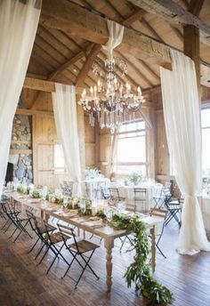 2107 trend of cascading greenery, chandeliers and draping create a chic setting