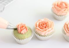 For a more realistic rose, use two shades of the same color buttercream. Start with the darker hue for the center of the rose and use the lighter shade on the outer petals.    As you pipe half circles, be sure to overlap the petals. As you travel outward make your half circles slightly bigger and longer.   Tah-dah! Now you can present a bouquet of rose cupcakes!   As I said before, these would be great for mom on Mother's Day. I also think these mint julep cupcakes would be perfect ...