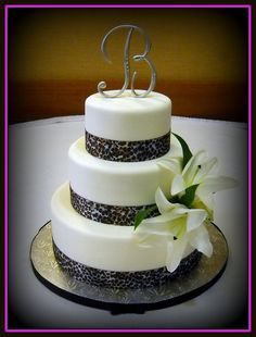 """Leopard Wedding cake... for the """"sprinkle""""! Its still black and white but with leopard that she loves! lol @Evelyn Burri Chianca"""