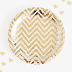 These gorgeous chevron gold foiled party plates by Illume Design are sure to delight.   #partyware #partyplates #plates #event #styling #partyshop #partydecor #firstbirthday #bridalshower #babyshower #christening #teaparty #partytheme #paper #eventplanning #designerkids #designerbaby #homewares #designer #style #love #food #partyinspo #littlebooteekau #metallic #gold #chevron #illume