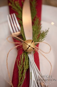christmas party dinner table setting with red napkin green garland tied up with . , christmas party dinner table setting with red napkin green garland tied up with twine and a gold bell. Noel Christmas, Winter Christmas, Christmas Crafts, Green Christmas, Christmas Napkins, Simple Christmas, Modern Christmas, Christmas 2019, Beautiful Christmas