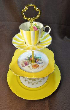 Get a splash of sunlight, even if the weather outside is frightful! A glorious teacup/saucer duo in yummy yellow and white stripes is
