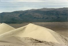 """Eureka Sand Dunes in Death Valley National Park, California (USA). Almost 700 feet/213 meters high,  they're 1 of the highest dune fields in North America & 1 of the best places in the world to witness the """"singing sand"""" phenomena. The original source of this sand is still unknown."""