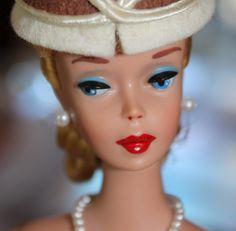that blue eyeshadow, black eyeliner, red lipstick, and pearl earring ... Vintage Barbie