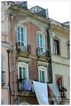 'Italian Architecture' by photographer Claire McCall. Town of Cagliari in Sardinia, Italy. Various prints variations available framed or unframed.