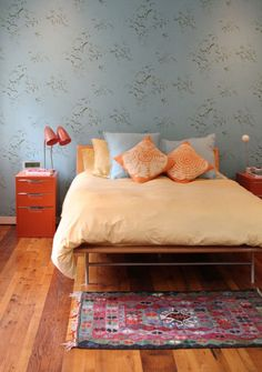 Lovely room with sweet area rug at the foot of the bed..