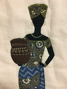 Afrikansk kvinde i blå og grøn - detalje fra quilten.