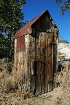 Abandoned Wooden Privy with Classic Crescent Moon Cut In Door and Rusty Tin Roof, Back Country Wilderness, Sierra Nevada