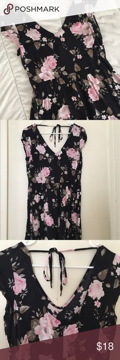 Black and Pink Floral Casual Dress Light and cute, perfect for summer. Zips and ties in the back. Lightweight/thin material. Black background with pink flowers. The size on the tag is large, but I modeled it (I'm a small) and it had potential to fit me, and it was too small for my friend who bought it as a large. Probably best if you're a medium size. Originally from aeropostale, but using Brandy for exposure. Brandy Melville Dresses Mini