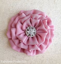 This flower brooch/pin and hair clip was hand-stitched with fabulous mauve color georgette fabric and embellished with a rhinestone silver tone