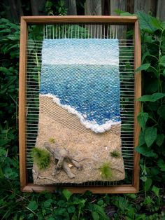 am thinking of a driftwood frame with chunkier and organic fibers-sea scene for outside/ garden