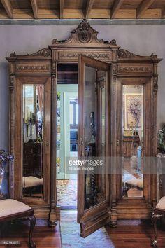 Ornate wardrobe used as doorway