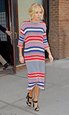 Sienna Miller looks effortlessly chic in vibrant multi-coloured dress #dailymail