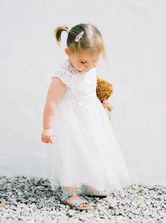 Ultimate flower girl cuteness: http://www.stylemepretty.com/destination-weddings/spain-weddings/2016/05/17/green-white-gold-beach-wedding-with-gorgeous-succulent-bouquet/ | Photography: Ana Lui Photography - http://www.analuiphotography.com/