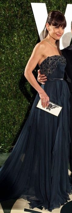 Katie Holmes wearing a pleated navy Elie Saab stunner, Lanvin clutch and two of the night's big trends: heavy bangs and a ponytail at The Vanity Fair Oscars After Party 2012