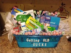 Gag gift I made for my father n laws 50th birthday! Get a basket, buy things for old people and put it in the basket, add lettering that say getting old sucks! Inside basket is.. Depends, big calculator, just for men hair color, daily pill holder, glasses, pills that I got from Walmart that say active adult 50+, hemorrhoid cream, muscle rub, male urinal, etc..