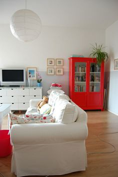 love the bright red cabinet - i freaking LOVE a bold color pop in a white room!