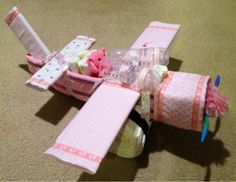 Flying Diaper Airplane Cake - If your looking to make homemade baby shower gifts, this Flying Diaper Airplane Cake is perfect for you.