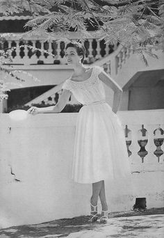 May Vogue 1954    Wearing a chalk-white cotton georgette dress by Claire McCardell.