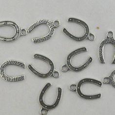10 Antiqued Silver Plated Horseshoe Charms Pendants. €1.50, via Etsy.