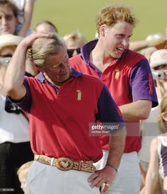 Prince William with his father Prince Charles accept the award for Highgrove Polo Team's victory in the Calcot Manor Hotel cup at Beaufort Polo Club, on June 19, 2005 in Gloucestershire, Tetbury, England. Highgrove defeated the Laird Team for this charity championship in aid of the Countryside Foundation for Education.