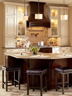 Fresh finishes. Today's kitchens mix decorative accents, tiles and countertops and cabinet finishes gracefully. Use a similar color as a thread to tie the styles together and top of the look with layers of lighting. Drum shades are not only functional but fashionable and great accents over your kitchen island as a final finishing touch.