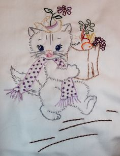 Hand embroidered kitten with groceries.
