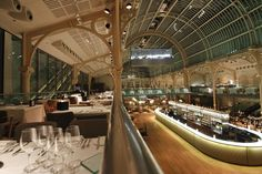 The vast Paul Hamlyn Hall at London's Royal Opera House now hosts a new champagne bar that is 13.5 metres long, has sixteen serving points a...