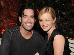 Amy Smart & Carter Oosterhouse  Actress Amy Smart married her handy boyfriend Carter Oosterhouse, host of HGTV's Carter Can,on Saturday, Sept. 10. The Shameless actress, 35, and the former Trading Spaces carpenter, 34, exchanged vows in front of 215 guests in Oosterhouse's hometown of Traverse City, Mich., where Smart's parents currently reside. The bride (best known for her role in Varsity Blues) wore a Carolina Herrera gown and sparkled in diamond Neil Lane jewelry.