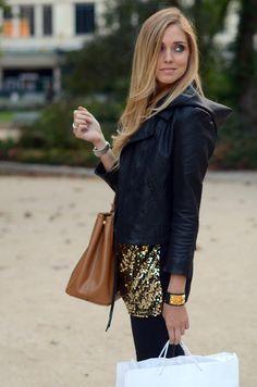 Chiara Ferragni - golden sequined skirt + black leather jacket + brown leather bag.