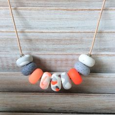 Orange and grey necklace, polymer clay necklace, beaded necklace handmade by rubybluejewels