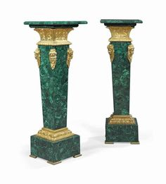 A PAIR OF FRENCH ORMOLU-MOUNTED MALACHITE PEDESTALS