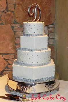 Salt Cake City Hexagon and Round with Bling Wedding Cake