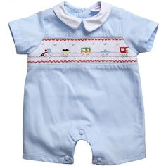 Annafie traditional British Heritage baby suit in pale blue cotton pique. This adorable romper is hand-smocked with a trains and has smart cloth-covered buttons between the legs and on the back.<br /> It is small fitting in the body length, so if your baby has a long body we suggest you buy a larger size. <ul> <li>100% cotton</li> <li>Machine wash at 30*C<br /></li> <li>Small fitting from neck to crutch</li> <li>Traditional British heritage hand-smocked design</li> </ul>