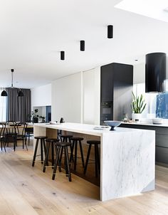 Elwood Townhouse,© Derek Swalwell Kitchen design love the layout and treatment of joinery between kitchen and living room