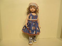 Outfit for 13 inch Effner Little Darlings or 14 inch Kish   eBay by robert8602. This view shows the sleeveless dress that closes in back with snaps, and the scarf is used as a belt. The cotton fabric is a dark blue background with brown and beige teddy bears. The hem is trimmed with brown cotton lace. Cute as can be.