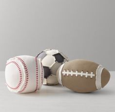 RH baby&child's Sports Ball Pillow:Bring their favorite field sport indoors with our cotton canvas pillow. Iconically shaped, the ball features frayed appliqués that impart tough, vintage-inspired character.