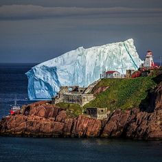 If you can, shift your eyes away from this massive #iceberg grounded in Fort Amherst, St. John's last year. To the bottom left you'll spot the @IcebergQuest tour boat, which was recently named one of the Top 11 Signature Experiences in Newfoundland & Labrador. You can see why. Photo by @shawnhudsonphoto #ExploreNL #travel