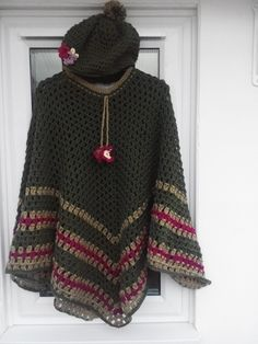 A green poncho with matching hat I crocheted.