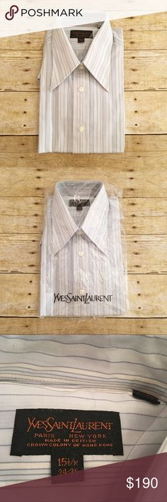 NWT blue striped dress shirt YSL top, 15 1/2 34-35 Vintage Yves Saint Laurent button down dress shirt. Size 15 1/2 m, 34-35. The tag indicates that this top was manufactured in the 70's. It is new in package, but the package is a little torn up. The mannequin photo shows a similar but newer style that is close to this one, but not exact. The pins and plastic inside the collar are still attached. Such a classic and handsome dress shirt made by an amazing company. Yves Saint Laurent Shirts…