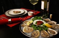Prince Edward Island oysters and white wine.