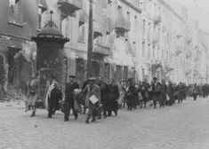 Jews rounded up during the Warsaw ghetto uprising are forced to march to the assembly point for deportation. Warsaw, Poland, April or May 1943.    http://www.ushmm.org/wlc/en/media_ph.php?ModuleId=10005188=703