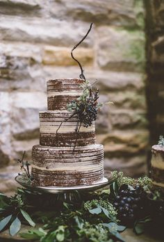 Brides.com: . A rustic three-tiered brown-and-white wedding cake with modern topper, created by Sassie Cakes.